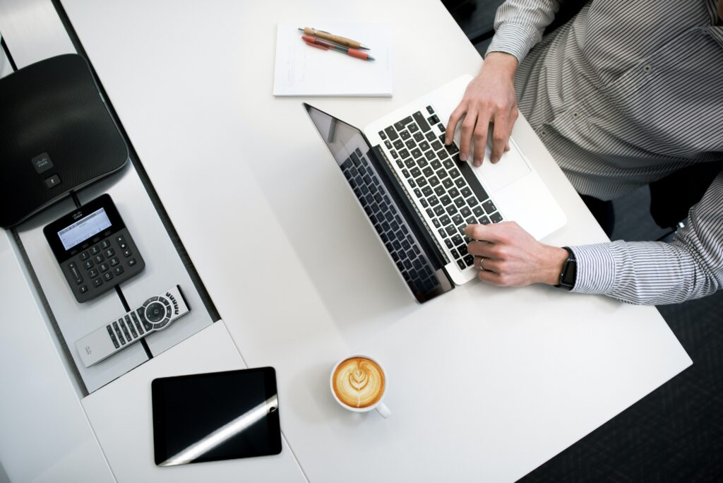 Corporate desk with laptop and coffee